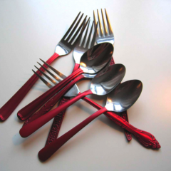 Cutlery Pieces with Red Handles by Anne Marchand part of 'Continuity in Diversity'